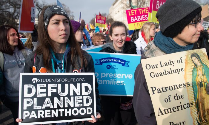 "Anti-abortion activists participate in the ""March for Life,"" an annual event to mark the anniversary of the 1973 Supreme Court case Roe v. Wade, which legalized abortion in the US, outside the US Supreme Court in Washington on Jan. 18, 2019. (Saul Loeb/AFP/Getty Images)"