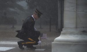 Severe Thunderstorm Didn't Deter This Soldier From Placing Flag at Tomb of the Unknown
