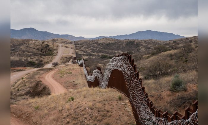 A general view of the US border fence, covered in concertina wire, separating the US and Mexico, at the outskirts of Nogales, Arizona, on Feb. 9, 2019. (Ariana Drehsler/AFP/Getty Images)
