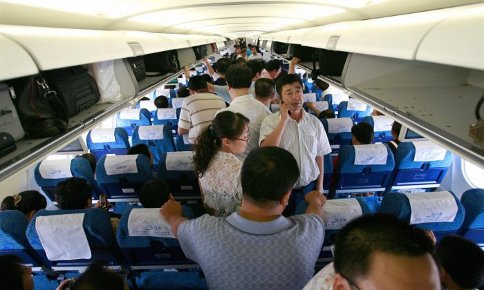 Inside a plane waiting at an airport. (Teh Eng Koon/AFP/Getty Images)