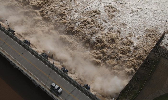 Water is released from the Keystone Dam into the Arkansas River northwest of Tulsa, Okla., on May 24, 2019. (Tom Gilbert/Tulsa World via AP)