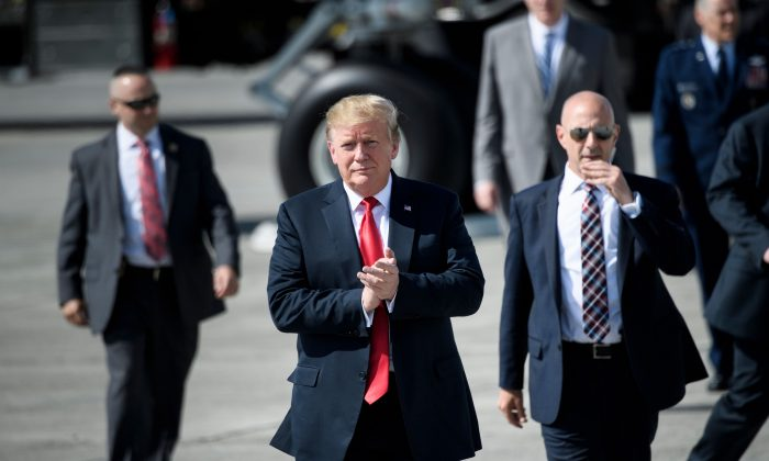 President Donald Trump walks on the tarmac at Elmendorf Air Force Base in Anchorage, Alaska during a refueling stop on May 24, 2019. (Brendan Smialowski/AFP/Getty Images)