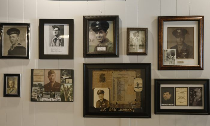 A group of photos at a tribute center for the Bedford Boys in Bedford, Va., on May 6, 2019.  AP Photo/Steve Helber