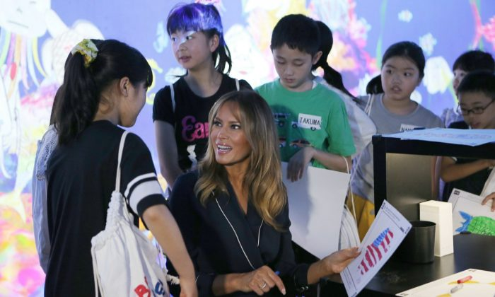 U.S. First Lady Melania Trump chats with children as she visits a digital art museum in Tokyo, Japan on May 26, 2019. (Koji Sasahara/AP)