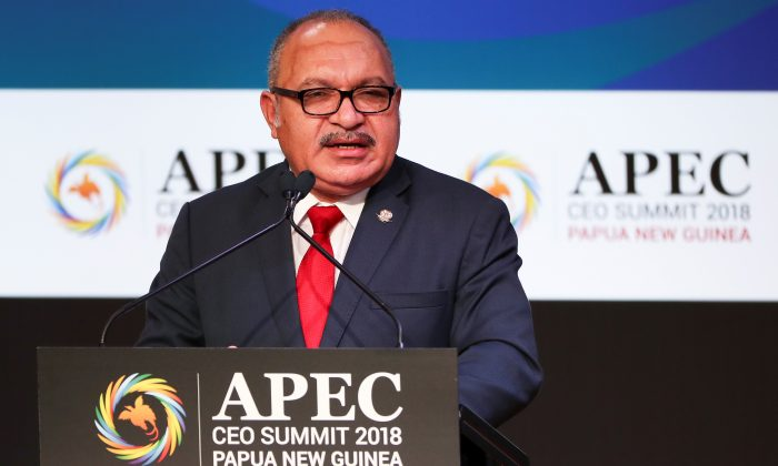 Papua New Guinea Prime Minister Peter O'Neill speaks during the APEC CEO Summit 2018 at Port Moresby, Papua New Guinea, on Nov. 16, 2018. (Fazry Ismail/Pool via REUTERS)