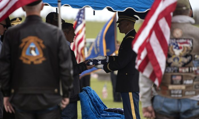 The honor guard presents Don McHenry, Pvt. William A. Boegli's eldest nephew, with a folded flag at Sunset Hills Cemetery in Bozeman, Mont., on May 25, 2019. (Rachel Leathe/Bozeman Daily Chronicle via AP)