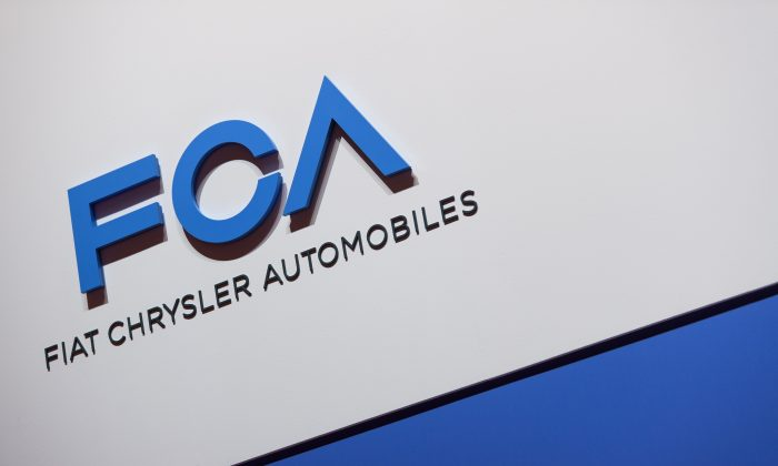 A FCA (Fiat Chrysler Automobiles) logo is displayed during a press day ahead of the Geneva International Motor Show in Geneva, on March 6, 2019. (Harold Cunningham/ AFP/Getty Images)