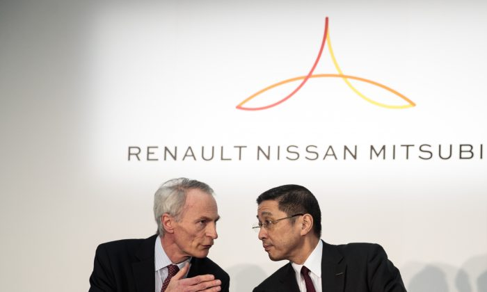 Renault chairman Jean-Dominique Senard (L) and Nissan Motors president and CEO Hiroto Saikawa (R) chat during a press conference at the Nissan headquarters in Yokohama, Kanagawa prefecture on March 12, 2019. (Behrouz Mehri/AFP/Getty Images)
