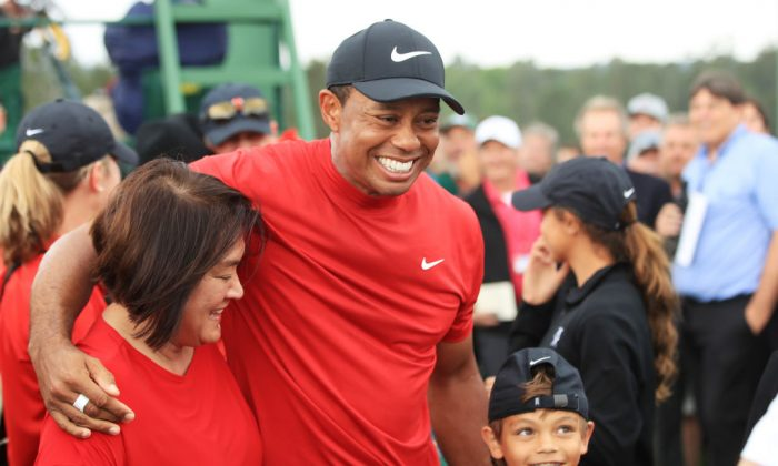 Tiger Woods celebrates with his son Charlie Axel during the final round of the Masters at Augusta National Golf Club in Augusta, Ga., on April 14, 2019. (Andrew Redington/Getty Images)