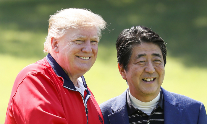 President Donald Trump (L) is welcomed by Japanese Prime Minister Shinzo Abe as he arrives to play golf at Mobara Country Club on May 26, 2019 in Chiba, Japan. (Kimimasa Mayama/Getty Images)