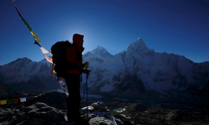 A trekker stands in front of Mount Everest in this file photo. (Reuters/Navesh Chitrakar/File Photo)
