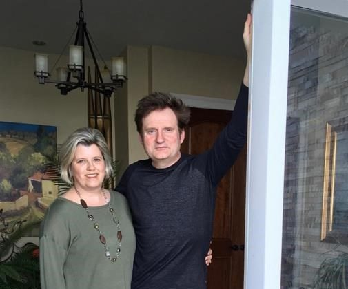 Lara Ryan and her husband Brett are shown at their home in Ferguson Cove, N.S. on Saturday, May 25, 2019 in a handout photo provided by Ryan. A Nova Scotia woman has come forward to warn people about an unusually cruel scam that involves the promise of free, pure-bread puppies. (HO-Lara Ryan/The Canadian Press)