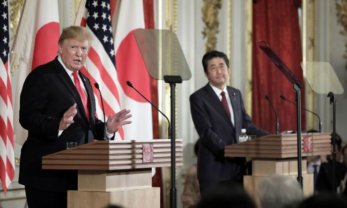 President Donald Trump, left, speaks as Shinzo Abe, Japan's prime minister, listens during a news conference at Akasaka Palace in Tokyo on May 27, 2019. (Kiyoshi Ota - Pool/Getty Images)