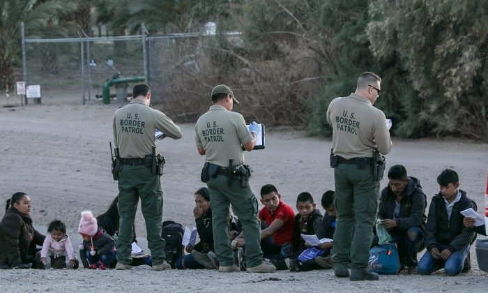 A group of illegal aliens is apprehended by Border Patrol after crossing from Mexico into Yuma, Ariz., on April 12, 2019. (Charlotte Cuthbertson/The Epoch Times)