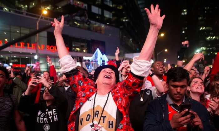 Toronto Raptors fans celebrate in the closing seconds of the team's 100-94 win over the Milwaukee Bucks to take the NBA Eastern Conference Championship, in Toronto on Saturday, May 25, 2019. The Raptors go to the NBA final for the first time in the franchise's history. (Chris Young/The Canadian Press)