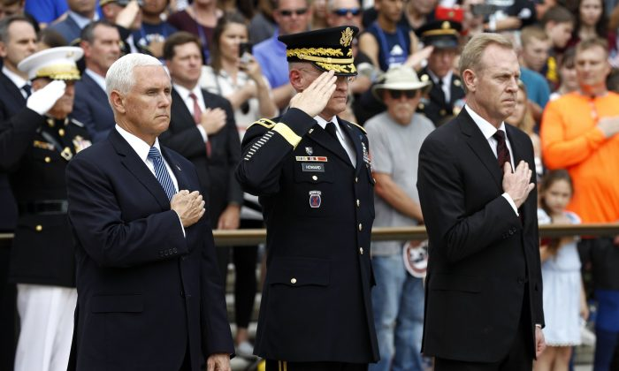 Vice President Mike Pence, from left, U.S. Army Maj. Gen. Michael Howard and Acting Defense Secretary Patrick Shanahan participate in a wreath-laying ceremony at the Tomb of the Unknown Soldier in observance of Memorial Day, Monday, May 27, 2019. (Patrick Semansky/AP Photo)
