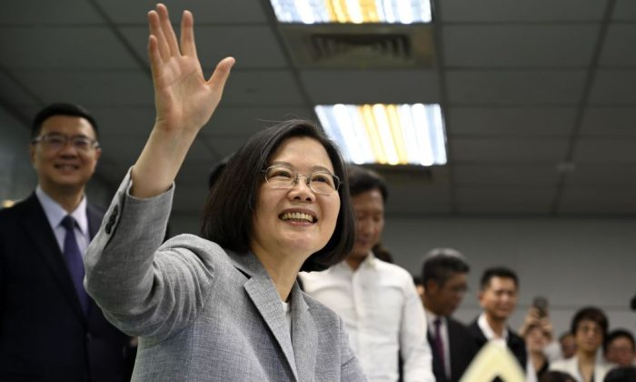 Taiwan's President Tsai Ing-wen waves while registering as the ruling Democratic Progressive Party (DPP) 2020 presidential candidate at the party's headquarter in Taipei on March 21, 2019. (Sam Yeh/AFP/Getty Images)