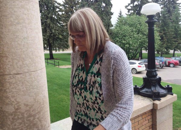 Angela Nicholson arrives at court in Prince Albert, Sask., on May 25, 2016. Two lovers who were convicted of plotting to kill their spouses in Saskatchewan are to be sentenced today. A jury found Curtis Vey and Angela Nicholson guilty in June of conspiracy to commit murder. (Jennifer Graham/The Canadian Press)