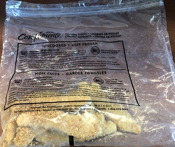 A bag of Compliments chicken strips that are subject to a recall issued May 24, 2019. (Canadian Food Inspection Agency)