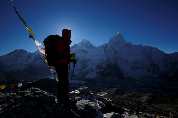 A trekker stands in front of Mount Everest, which is 8,850 meters high (C), at Kala Patthar in Solukhumbu District May 7, 2014. (Navesh Chitrakar/Reuters)