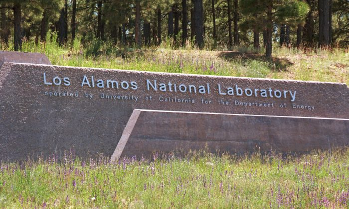 (FILE PHOTO)  A sign welcomes visitors to the Los Alamos Laboratory after they cross over the Omega Bridge June 14, 1999 in Los Alamos, New Mexico. (Joe Raedle/Getty Images)