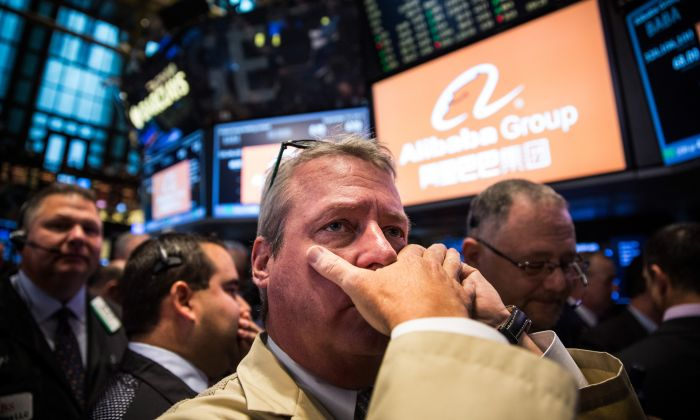 Traders work on the floor of the New York Stock Exchange while the price of Alibaba Group's initial price offering (IPO) is decided in New York City on Sept. 19, 2014. (Andrew Burton/Getty Images)