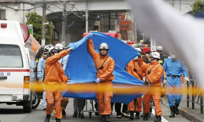 Rescue workers operate at the site where sixteen people were injured in a suspected stabbing by a man, in Kawasaki, Japan, on May 28, 2019. (Kyodo/via REUTERS)