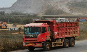 Chinese Freight Drivers Trapped in Trucks Face Discrimination