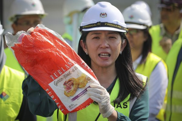 Malaysia's Minister of Energy, Science, Technology, Environment and Climate Change Yeo Bee Yin shows a sample of plastic waste