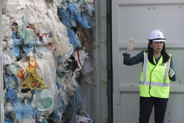 Malaysia's Minister of Energy, Science, Technology, Environment and Climate Change Yeo Bee Yin shows plastic waste