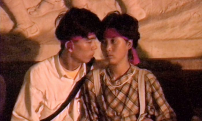 Screenshot of a young couple seated on the top step of the Monument to the People's Heroes in Beijing on June 4, 1989. Canadian journalist Arthur Kent shot this video around 3 a.m., before the army completely blocked off the east side of Tiananmen Square. (Courtesy Arthur Kent)