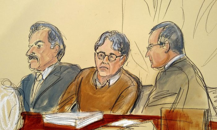 In this courtroom drawing, defendant Keith Raniere, center, is seated between his attorneys Paul DerOhannesian, left, and Marc Agnifilo during the first day of his sex trafficking trial on May 7, 2019. (Elizabeth Williams via AP)