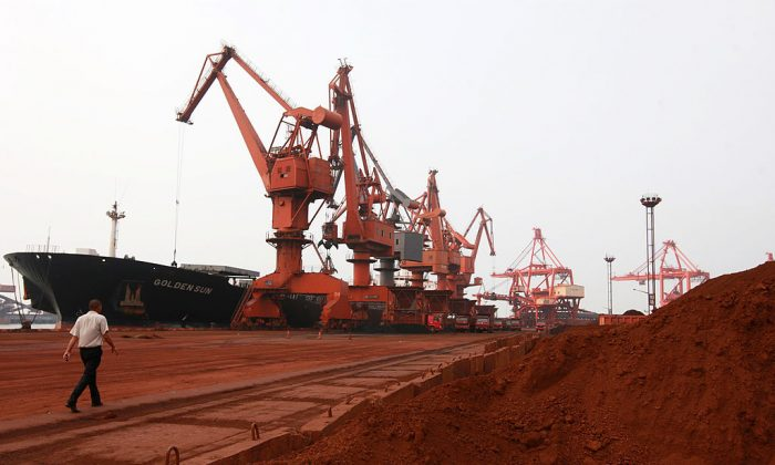 Bulldozer scoops soil containing various rare earth to be loaded on to a ship at a port in Lianyungang, China, on Sept. 5, 2010.  STR/AFP/Getty Images