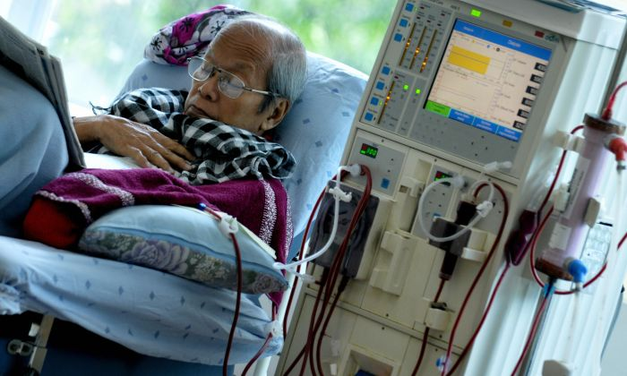 A stock photo of a patient in the hospital (Jay Directo/AFP/Getty Images)