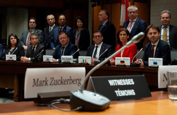Standing Committee on Access to Information, Privacy and Ethics Chair Bob Zimmer and members of the International Grand Committee on Big Data, Privacy and Democracy listen to a question from media during a news conference in Ottawa, Tuesday, May 28, 2019. (Adrian Wyld/The Canadian Press)