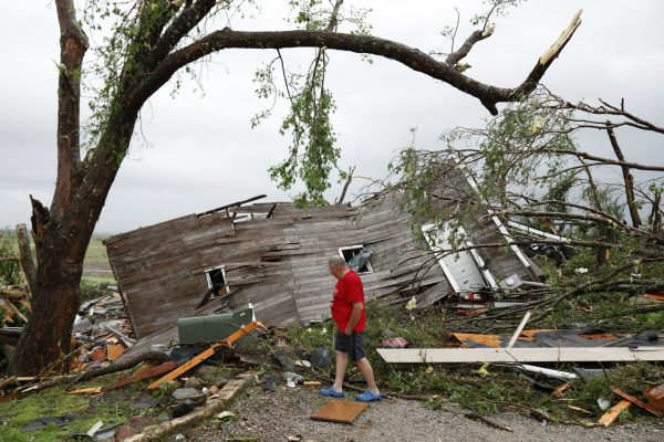 Joe Armison looks over damage to his home