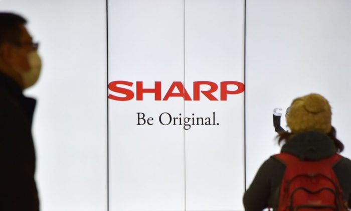 The logo of Sharp is displayed at a railway station in Tokyo on Feb. 17, 2017. (Kazuhiro Nogi/AFP/Getty Images)