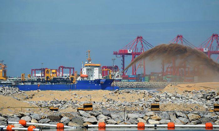 A dredger pumps sand to reclaim land just outside the Colombo Port on Nov. 23, 2016. (Ishara S. Kodikara/AFP/Getty Images)