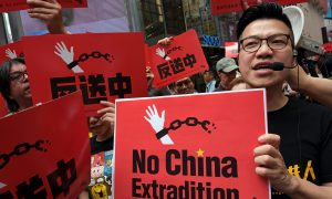 Hong Kong Lawyers Protest 'Polarizing' Extradition Bill in Rare March