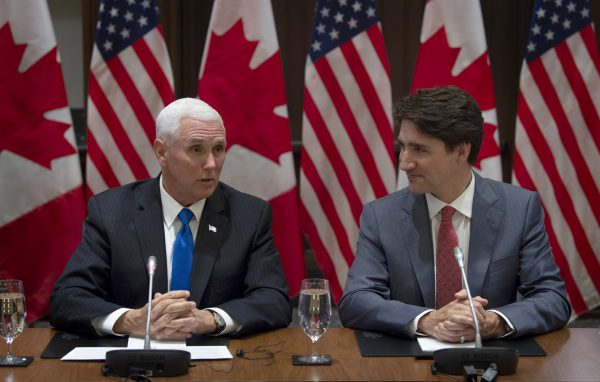 Canadian Prime Minister Justin Trudeau listens as U.S. Vice-President Mike Pence makes opening remarks at the Canadian Council for the USMCA on Parliament Hill in Ottawa on May 30, 2019. (Adrian Wyld/The Canadian Press)