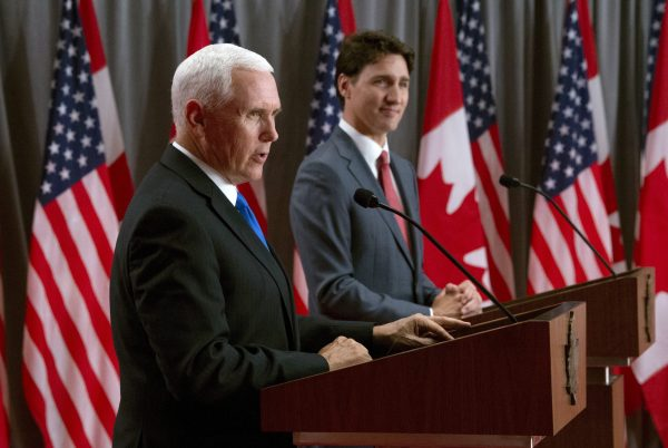Canadian Prime Minister Justin Trudeau listens as U.S. Vice-President Mike Pence makes his opening statement during a joint news conference in Ottawa on May 30, 2019. (Adrian Wyld/The Canadian Press)