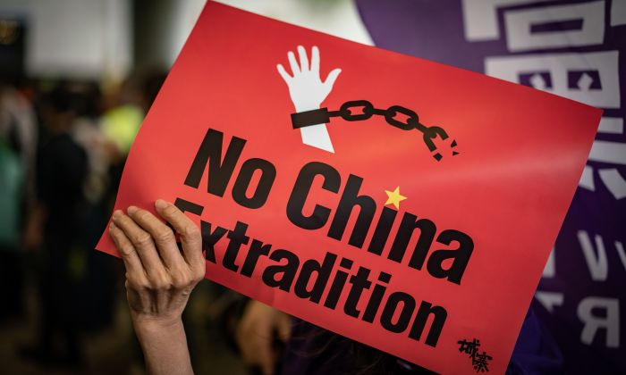 A protester holds a placard during a rally against the extradition law outside the Legislative Council building in Hong Kong on May 4, 2019.  (Anthony Kwan/Getty Images)