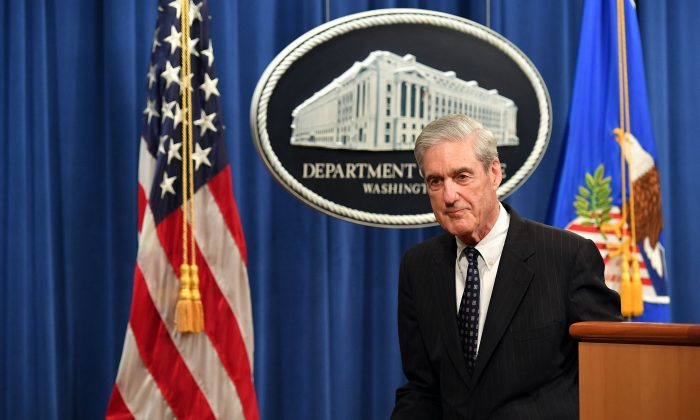 Then-Special Counsel Robert Mueller leaves after speaking on the investigation into Russian interference in the 2016 Presidential election, at the US Justice Department in Washington, DC, on May 29, 2019. (Photo by MANDEL NGAN / AFP)        (Photo credit should read MANDEL NGAN/AFP/Getty Images)