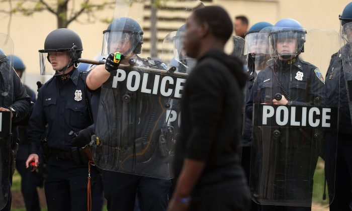 A Baltimore Police officer aims his taser at a demonstrator outside the Mondawmin Mall following the funeral of Freddie Gray in Baltimore, Md., on April 27, 2015. Gray, 25, was arrested for possessing a switch blade knife on April 12 outside the Gilmor Homes housing project on Baltimore's west side.  Chip Somodevilla/Getty Images