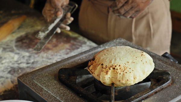 fulka roti or chapati puffed up over a flame