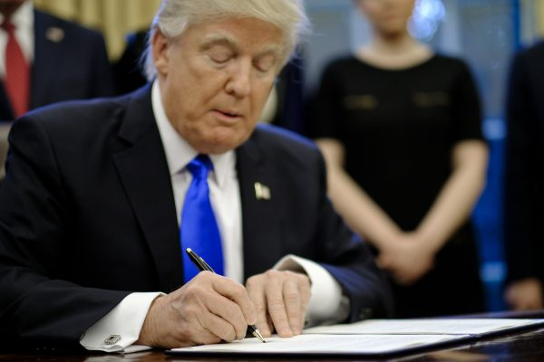 President Donald Trump signs three executive actions
