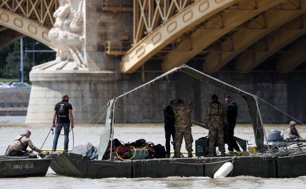 A rescue team is seen at the site of a ship accident, which killed several people, near Margaret Bridge on the Danube river in Budapest, Hungary, May 31, 2019. (Bernadett Szabo/Reuters)