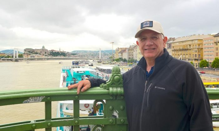 """Ken Hoffer, of Halifax, poses on the Liberty Bridge above the Danube River in Budapest, Hungary, on May 30, 2019. A Canadian tourist who was on the Danube River in Budapest when two boats collided on May 29 says the experience was """"surreal and """"sobering"""". Ken Hoffer, of Halifax, says he was on a cruise boat about two bridges down from where the crash occurred, when he saw a man in a life ring float by in the chilly and fast moving water. (HO - Ken Hoffer/The Canadian Press)"""