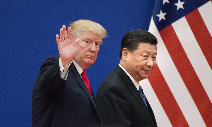 President Donald Trump (L) and Chinese leader Xi Jinping leave a business leaders event at the Great Hall of the People in Beijing on Nov. 9, 2017. (Nicolas Asfouri/AFP/Getty Images)