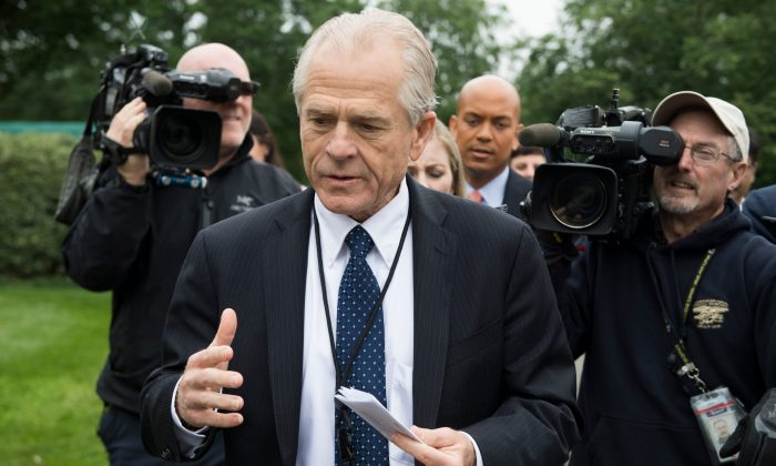 White House Director of Trade Policy Peter Navarro (C) dodges the press after speaking on Fox News at the White House in Washington on June 4, 2018. (JIM WATSON/AFP/Getty Images)